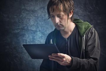 Man Reading News on Digital Tablet Computer