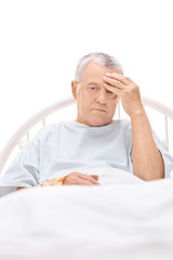 Patient having a headache and lying in hospital bed