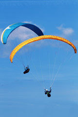 two paraglider flying in the air