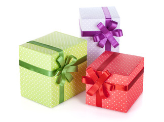 Three colorful gift boxes with ribbon and bow