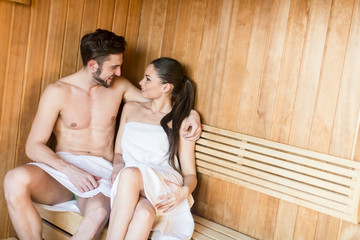 Young couple in the sauna