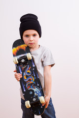 Young boy in a  hat and skateboard