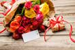 Leinwanddruck Bild - Blumenstrauß mit einem Geschenk