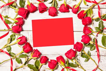 Frame of fresh roses with empty card