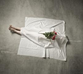 death body under white cloth