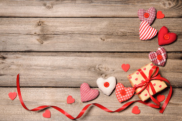 Gift box with red ribbon and textile hearts