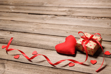 Heart and gift box with red ribbon