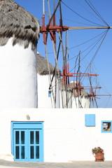 Windmills on a hillside near the sea in Mykonos Island, Greece