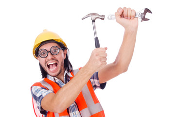 Funny young construction worker with hammer and wrench isolated