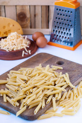 Uncooked pasta and grated cheese