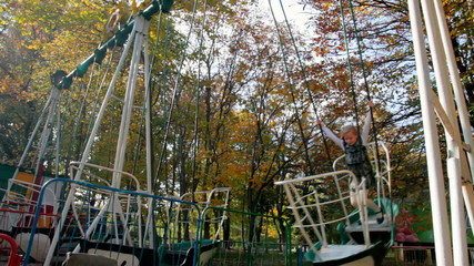Child riding on a swing at the playground