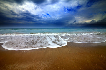 Sea beach and storm clouds