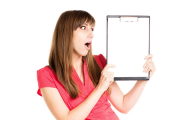 Amazed girl with advertising blank board