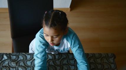 young girl at table having fun
