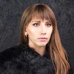 Fashion beauty girl with long hair wears fur coat