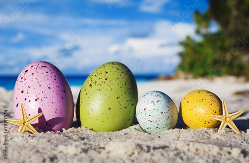 Colorful easter eggs on ocean beach