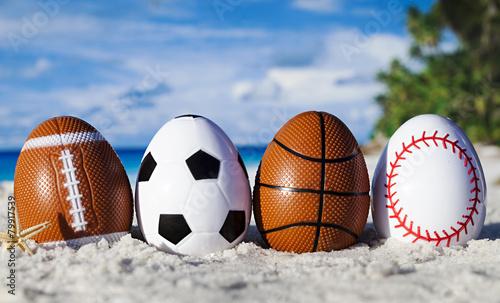 Sport eggs on ocean beach –easter symbol - 79917539