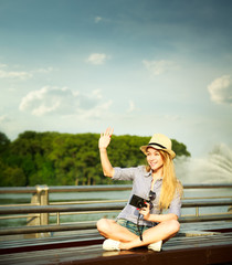 Happy Young Hipster Girl Waving Hello