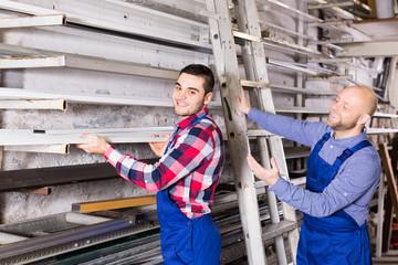 workmen inspecting window frames