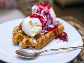 waffle with ice cream and cherry