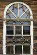 The old window in the wooden house