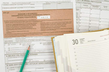 Polish tax form with pencil and calendar