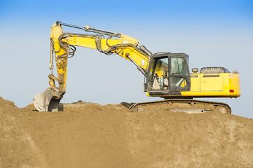 Excavator on a sand dune