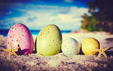 Colorful easter eggs on ocean beach – retro style