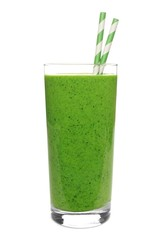 Green smoothie in a glass with straws isolated on white