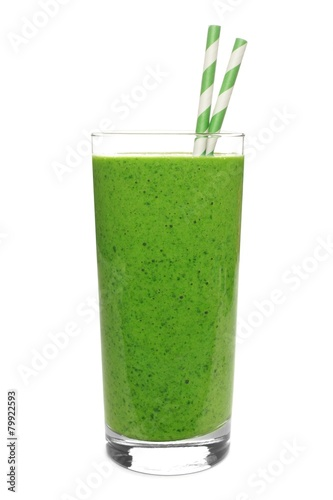 Leinwanddruck Bild Green smoothie in a glass with straws isolated on white