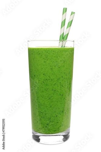 Leinwandbild Motiv Green smoothie in a glass with straws isolated on white