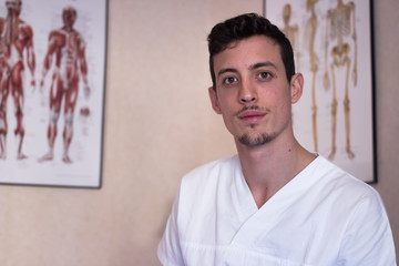 young osteopath in his office