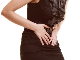Indigestion. Closeup of woman suffering from stomach pain.