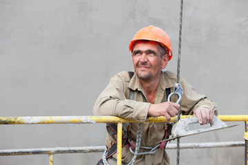 Plasterer worker looking at distance during construction works