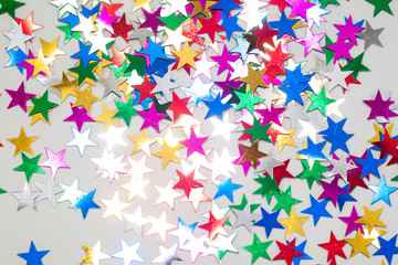 many toy stars on white background