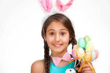 happy little girl with eggs and Bunny ears. Easter photo