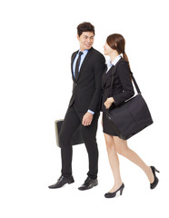 happy businessman and businesswoman walking together