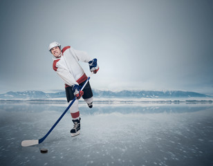Aggressive Hockey player on the frozen Lake