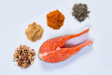 Salmon steak with spices and seasonings