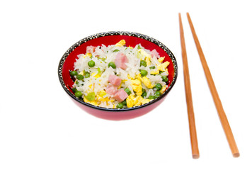Cantonese rice with chopsticks on white background