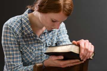 Woman with a Bible Praying