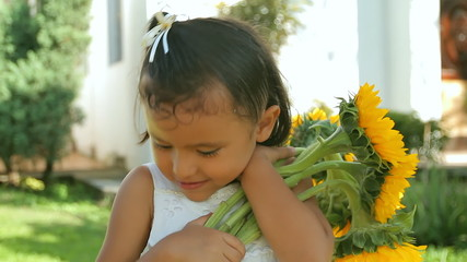 Hispanic Girl Holding Sunflowers