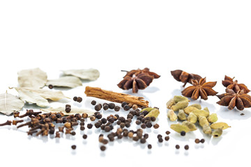 Assorted exotic spices on white background