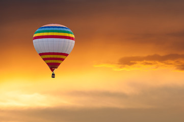 Hot Air Balloon in Flight on sunset sky background. Festival of
