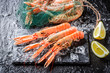 Fresh langoustines on black rock - 79927148