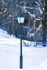 lamppost in snowy park 2