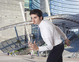 Determined businessman running in the city poster