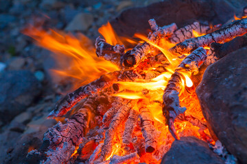 Campfire in rock fire ring at dusk