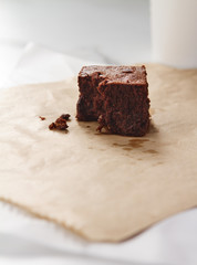 Close up of a delicious chocolate brownie on pale background