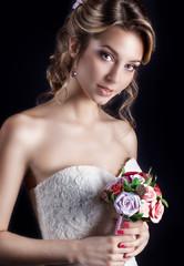 happy  girls in white wedding dress with a wedding bouquet